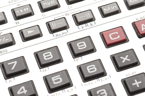 Close up shot of gray calculator digits